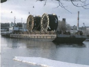 reels on barge with ice